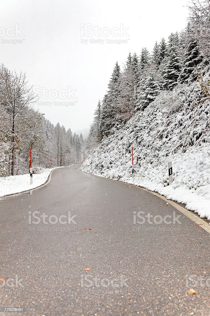 snowy road and bad weather in winter royalty-free stock photo