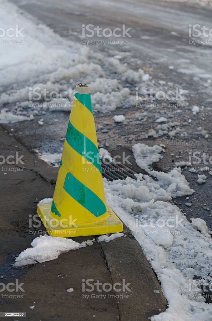 Snowy road and triangular cone stock photo