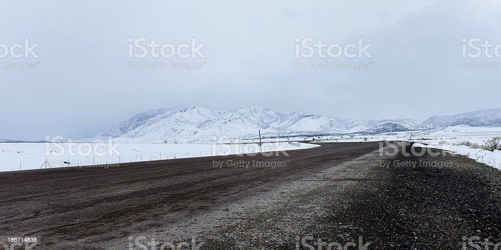 Snowy Road - Horizontal royalty-free stock photo
