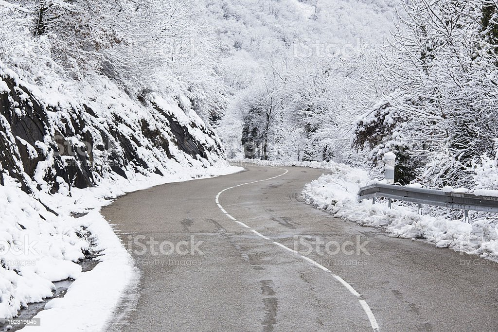 Snowy road in France stock photo