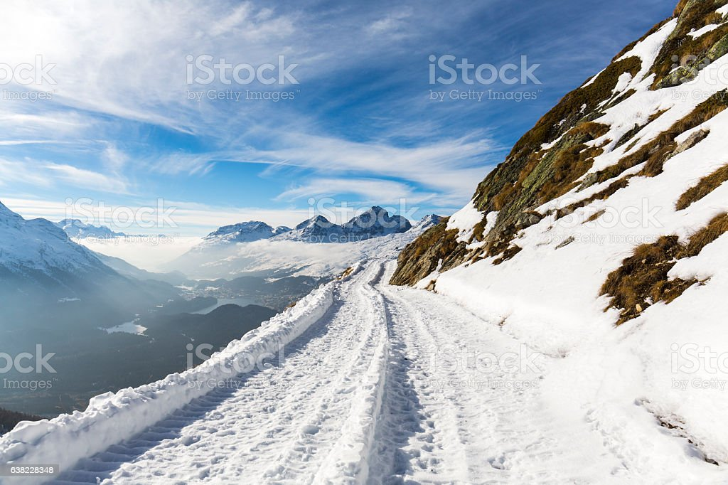 Snowy road in high mountains stock photo
