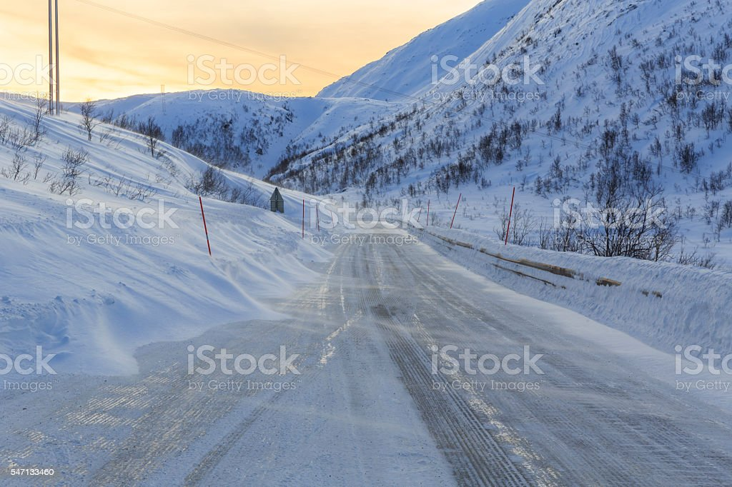 Snowy road on Senja Island stock photo