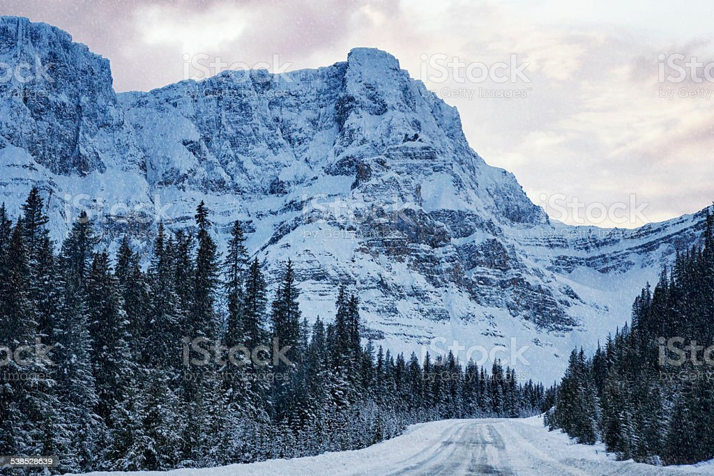 Snowy Road Through the Mountains stock photo
