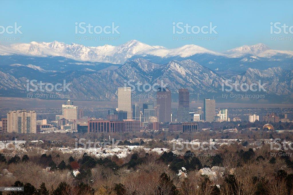 Snowy Rocky Mountains and Downtown Denver Colorado skyscrapers neighborhood stock photo
