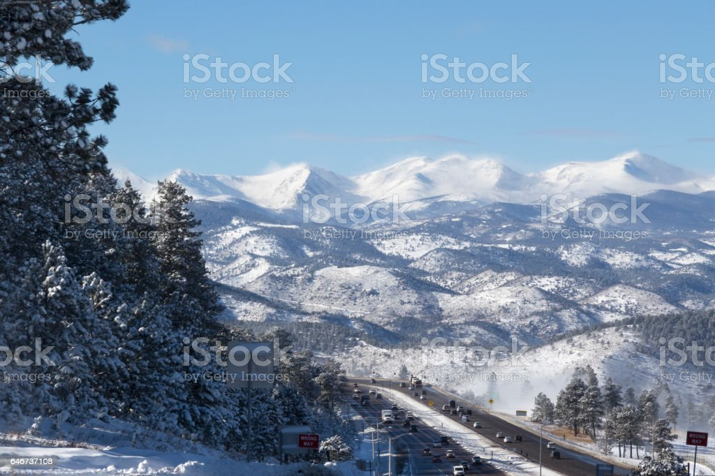 Snowy Rocky Mountains Interstate-70 highway traffic Genesse Colorado stock photo