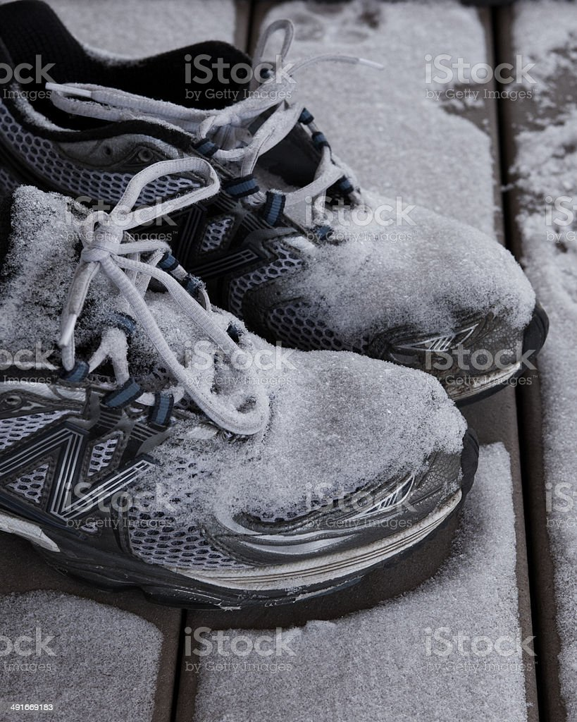 Snowy running shoes stock photo