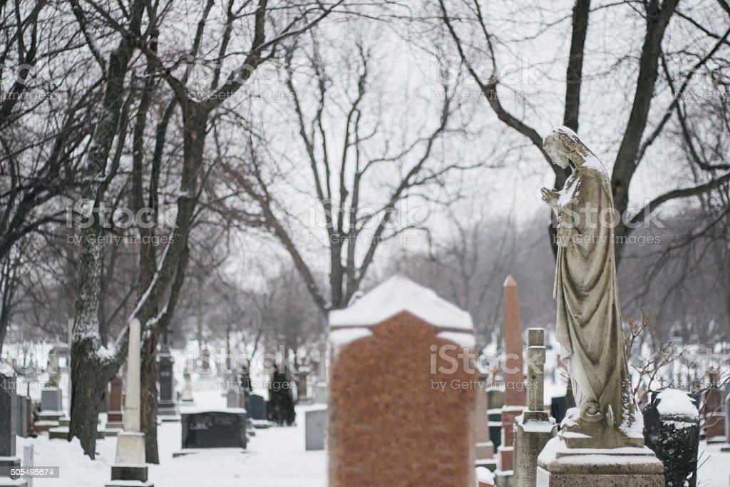 Snowy saint statue stock photo