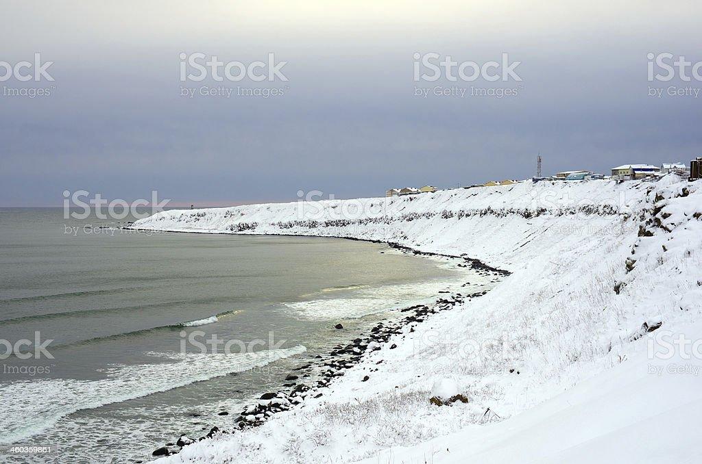 Snowy shore of the island Kunashir stock photo