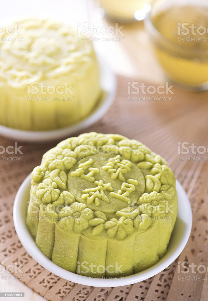 Snowy skin green tea with red bean paste mooncake stock photo