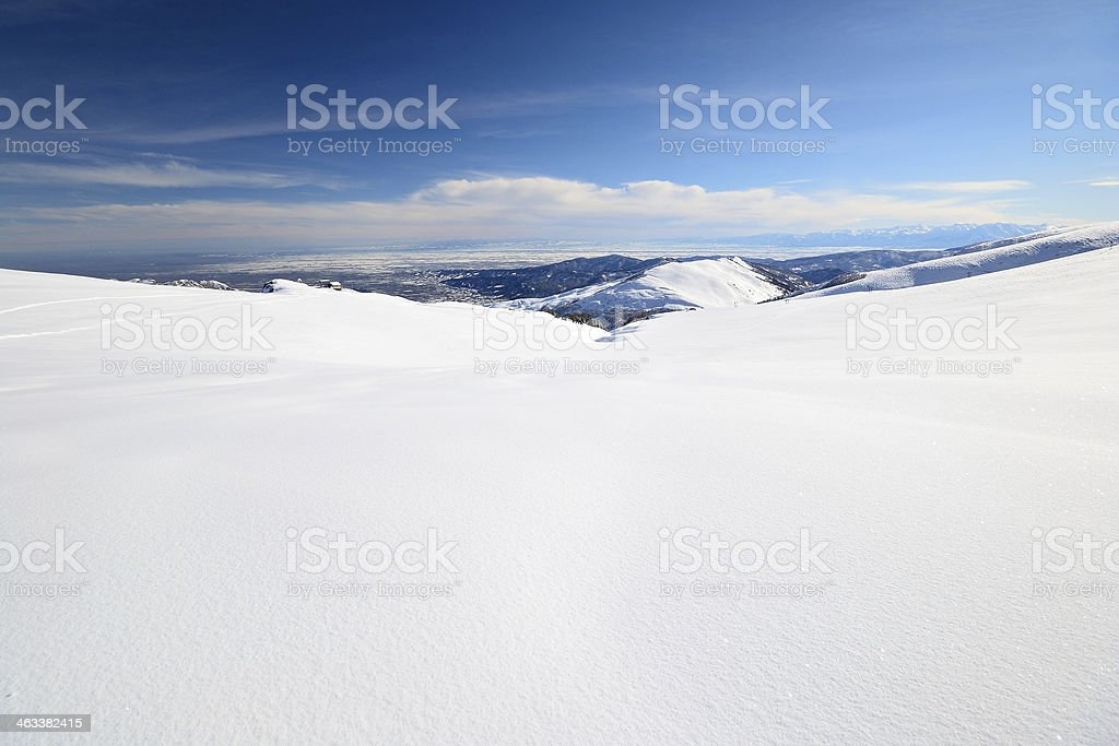 Snowy slope with superb panoramic view royalty-free stock photo