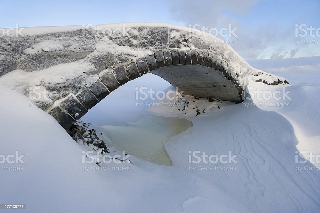 Snowy stone bridge royalty-free stock photo
