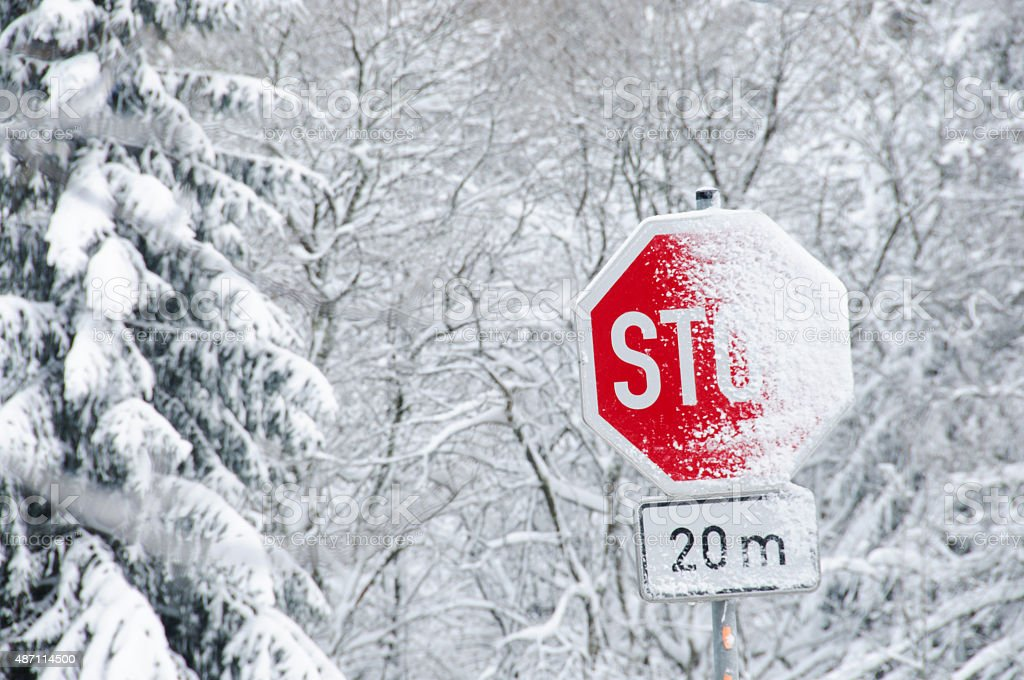 Snowy Stop Traffic Sign stock photo