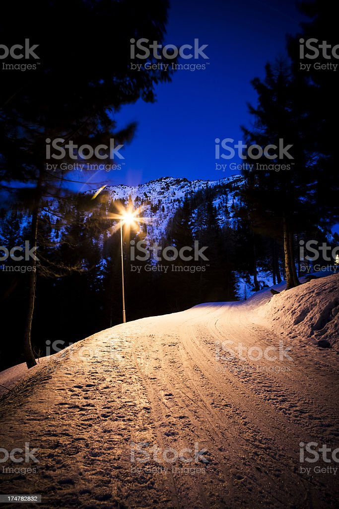 Snowy street at night royalty-free stock photo