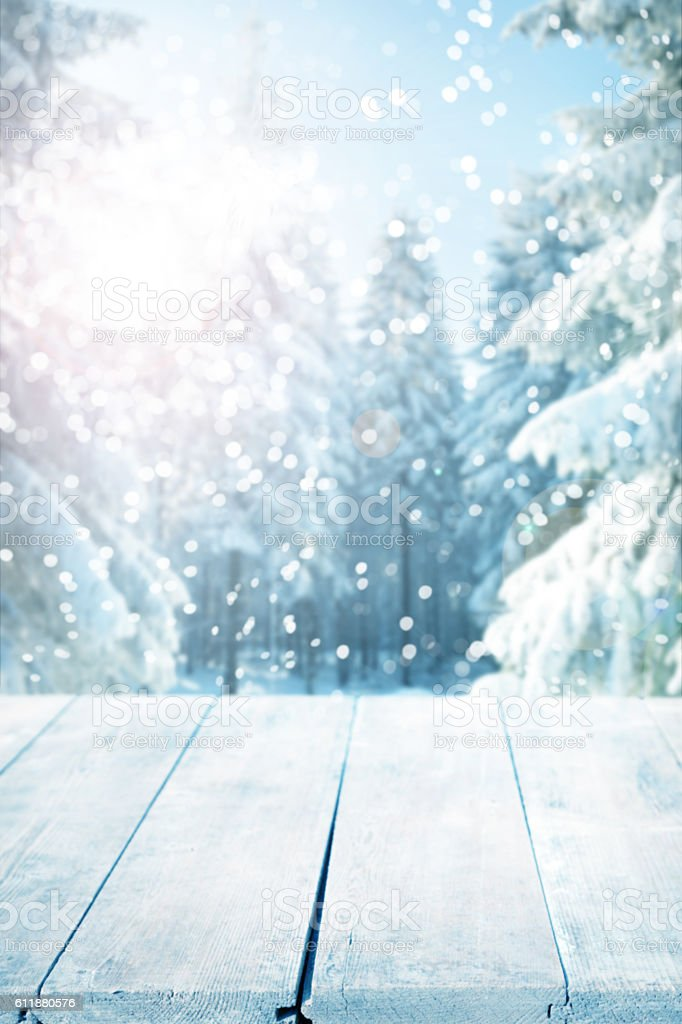 Snowy winter background with empty wooden planks stock photo