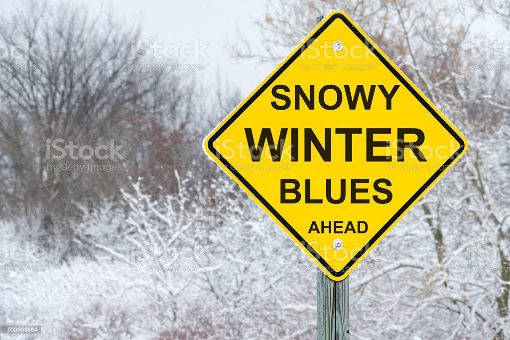 Snowy Winter Blues Road Warning Sign stock photo
