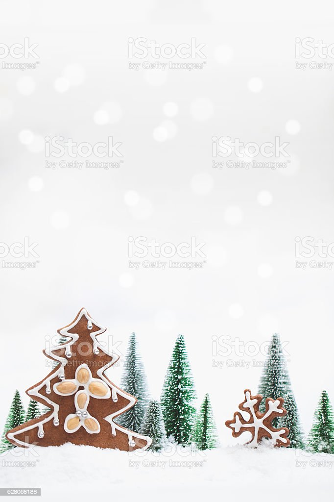 Snowy Winter Forest with gingerbread christmas tree stock photo