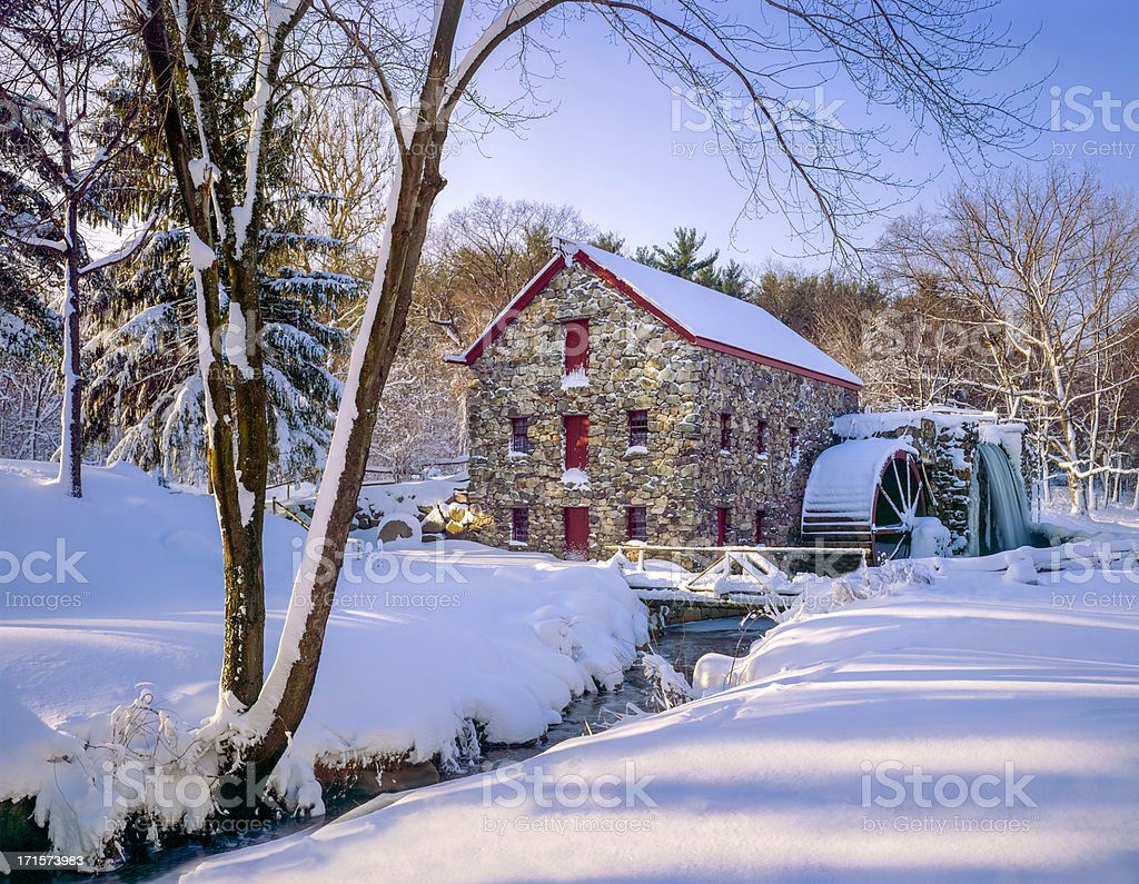 snowy winter gristmill, early morning light stock photo