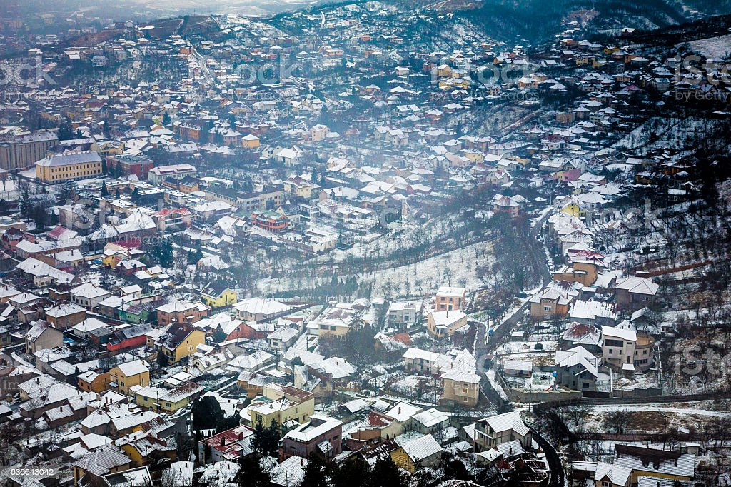 Snowy winter town and landscape in Transylvania, Romania stock photo