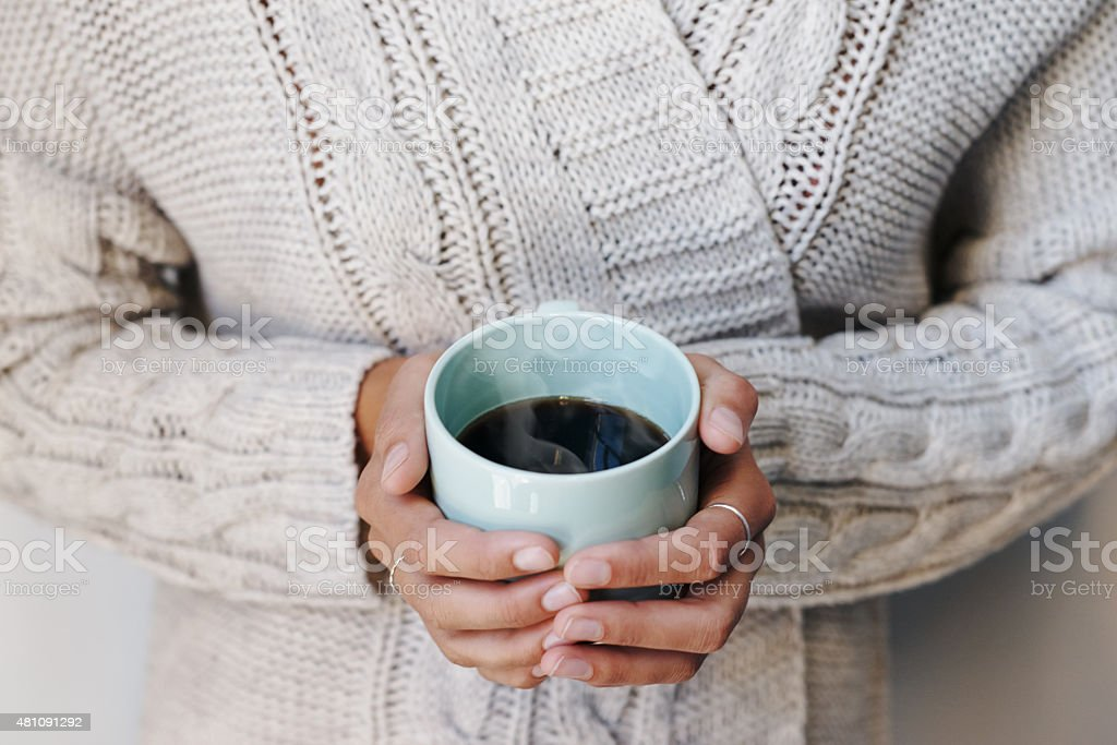 Snug with a nice mug of coffee stock photo