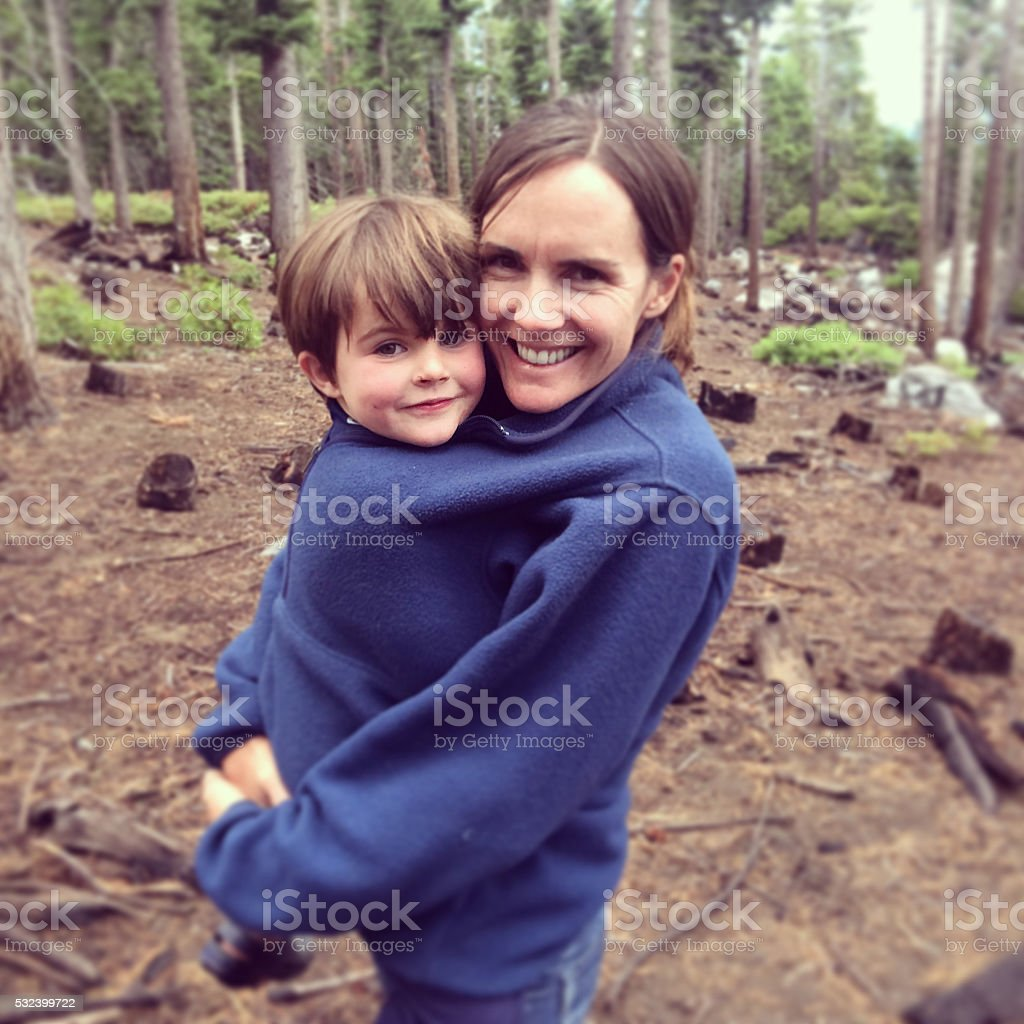Snuggles with mom and son stock photo