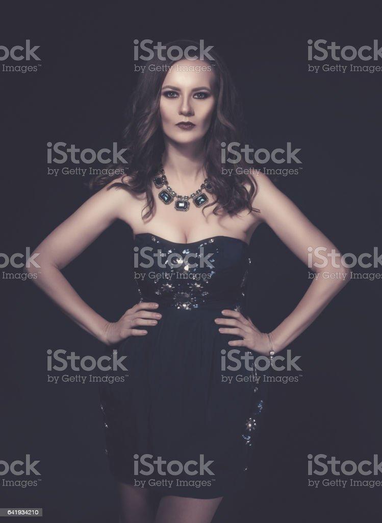 so elegant woman in black dress stock photo