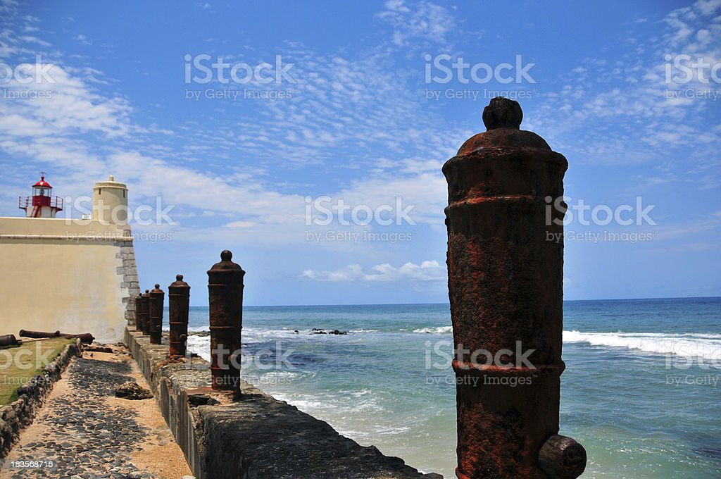 São Tomé: line of Portuguese bronze cannons and the Ocean stock photo