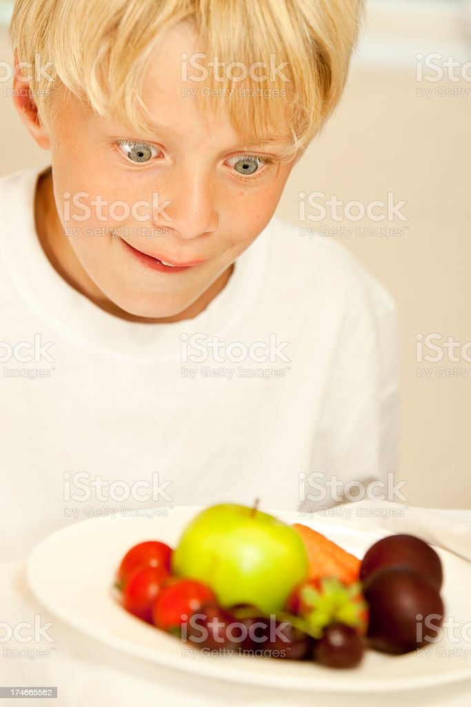 so wide eyed and excited by healthy fruit snack royalty-free stock photo