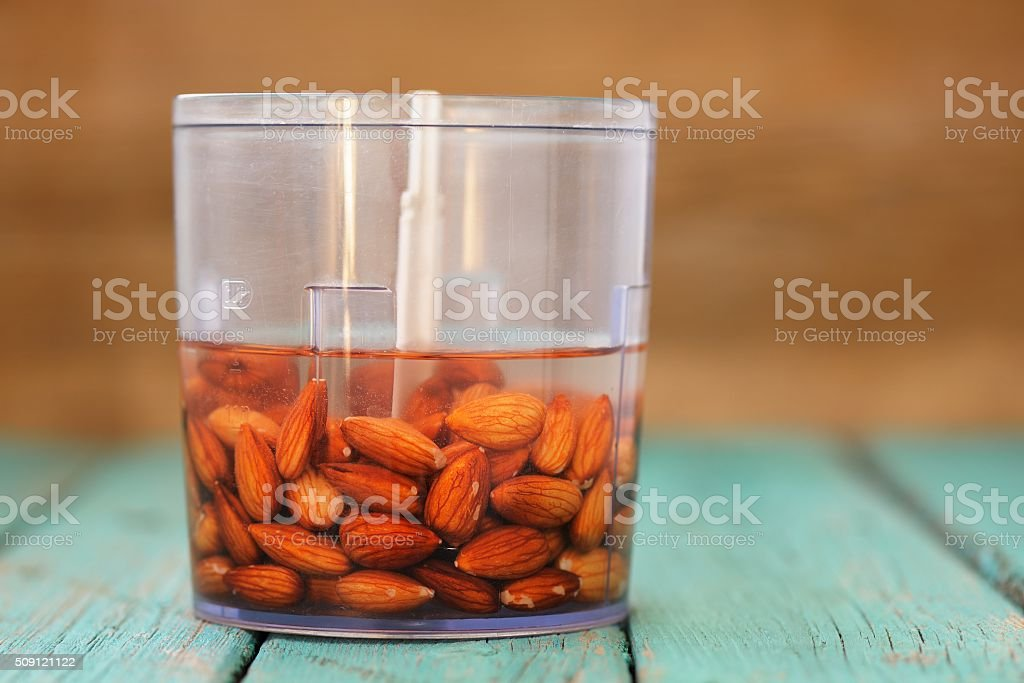 Soaked almonds ready for making almond milk in blender stock photo