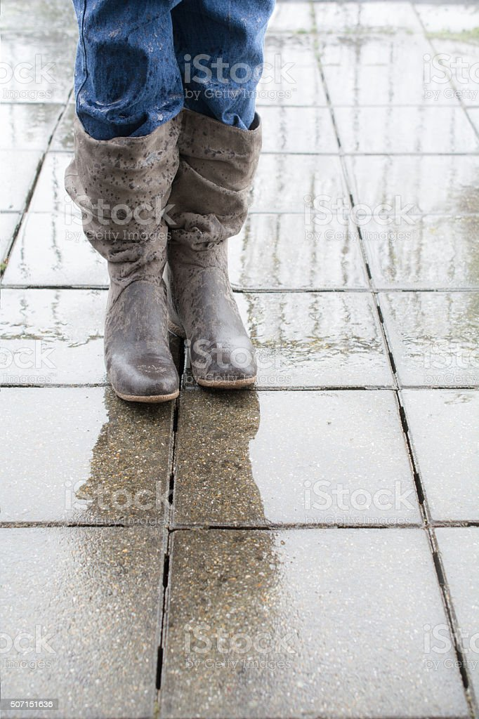 Soaked comfy boots in the Rain stock photo