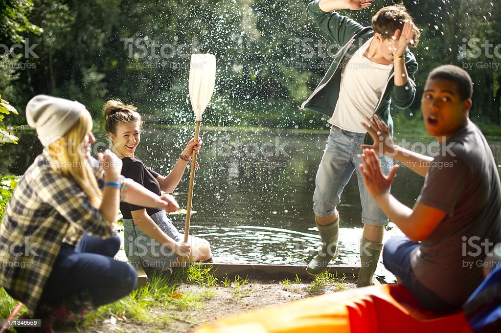 soaked teen splashes her friends royalty-free stock photo