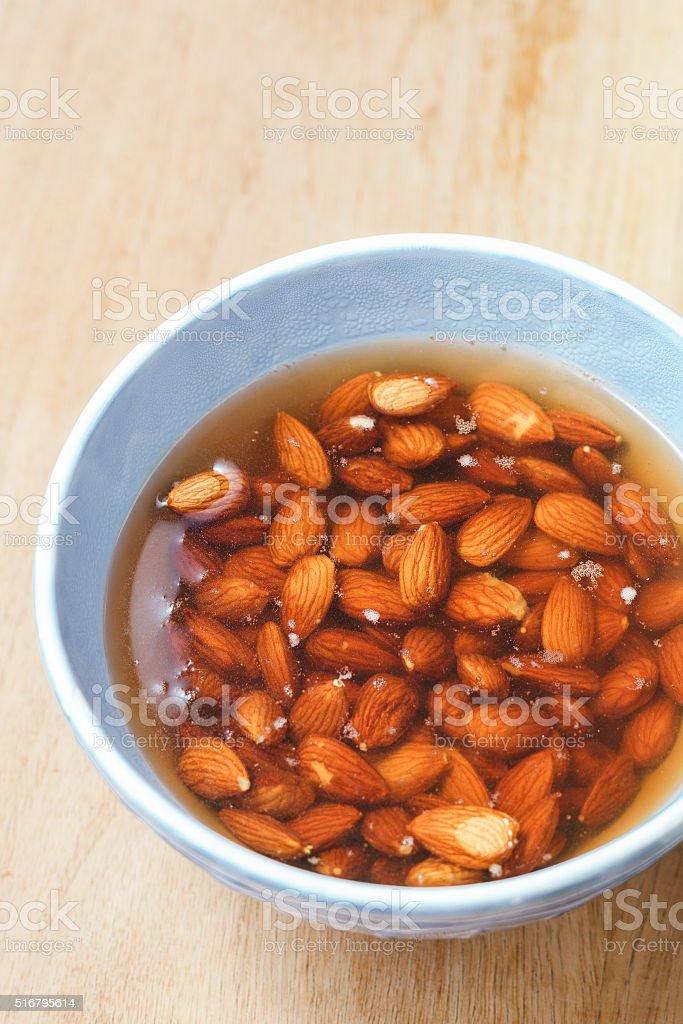 Soaking almond nuts stock photo