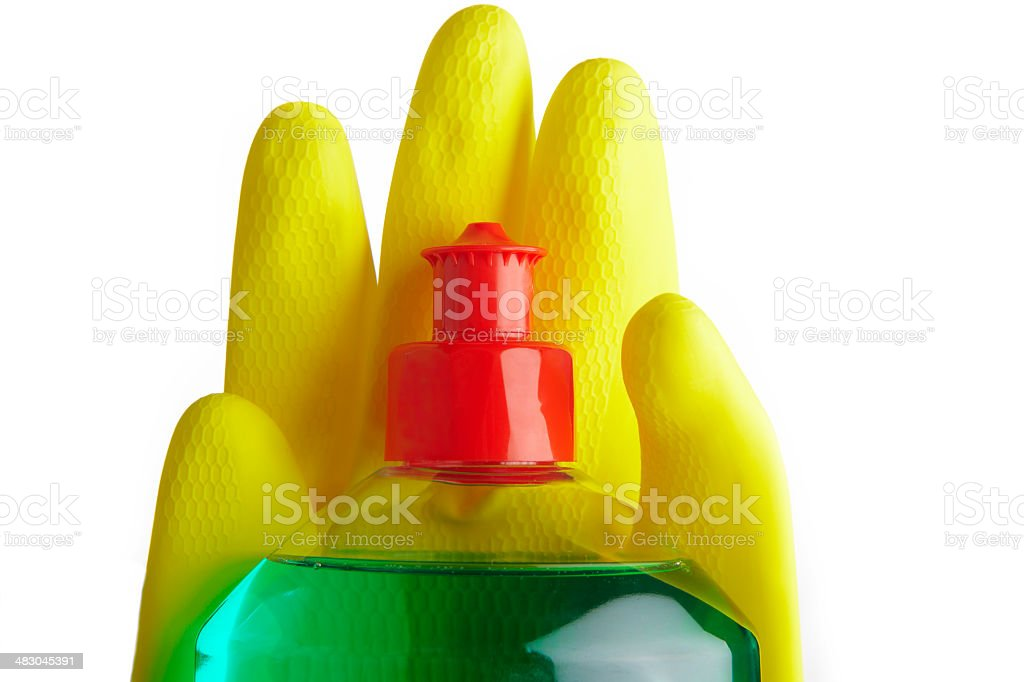 Soap bottle and yellow gloves. stock photo