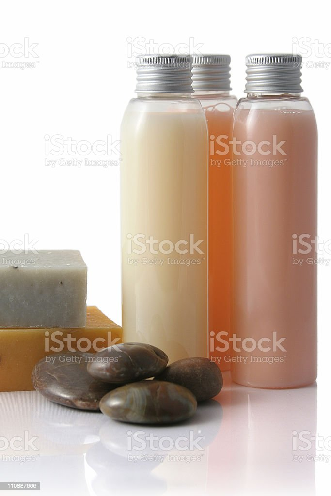 Soap bottles and pebbles royalty-free stock photo