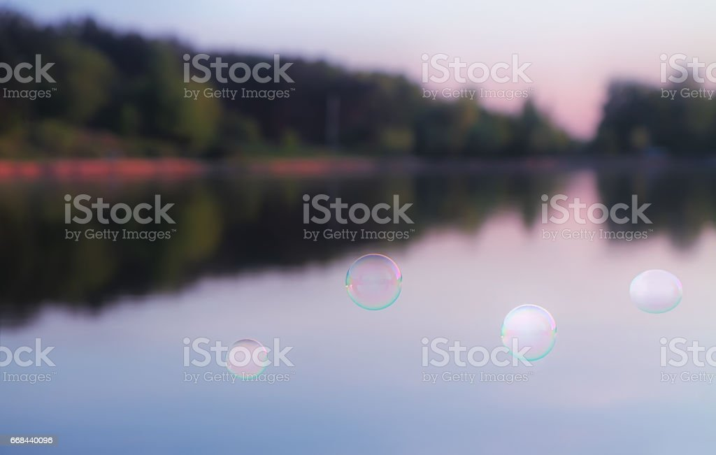 Soap Bubbles Against The Blurred Nature Background stock photo