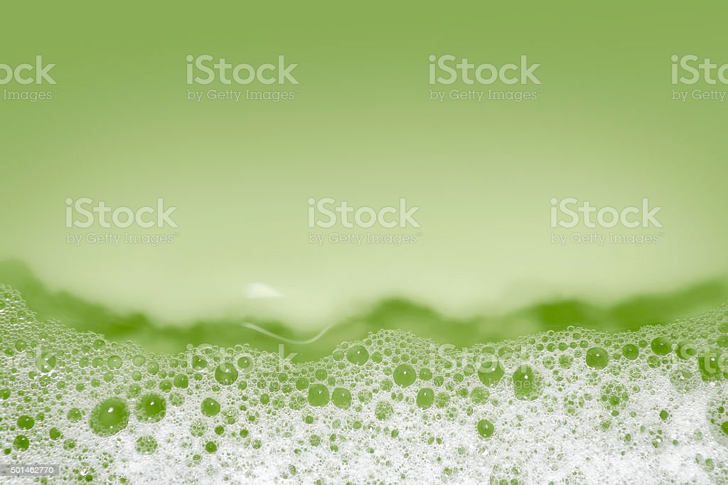 Soap bubbles background (green) stock photo