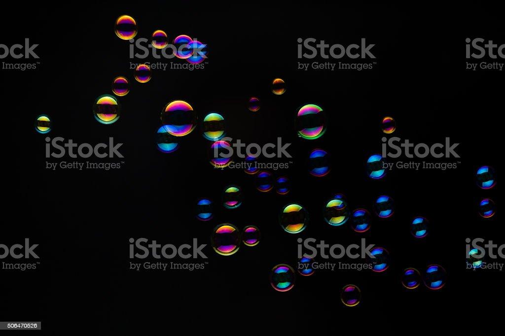 Soap Bubbles On A Black Background stock photo