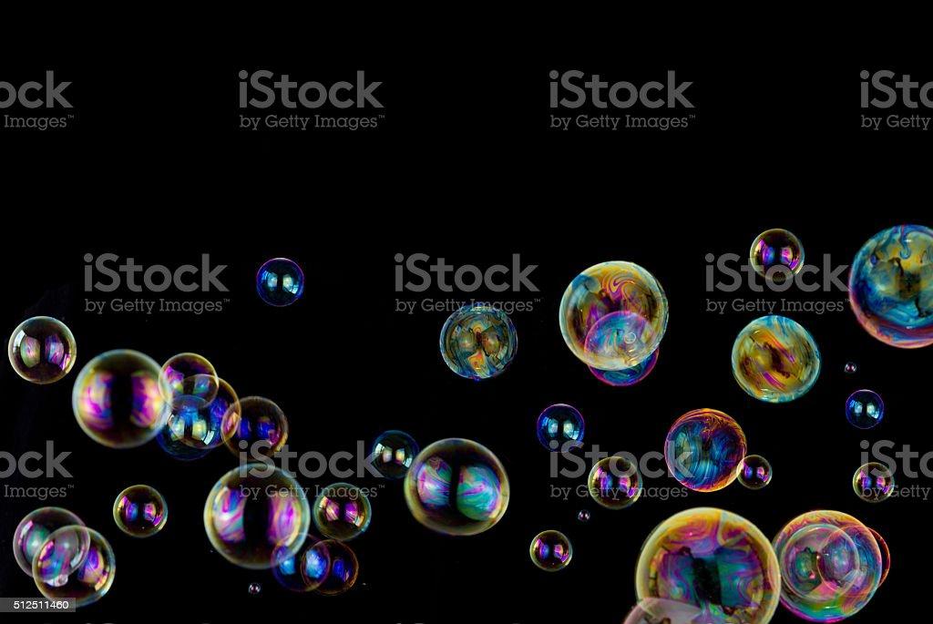 soap bubbles on black stock photo