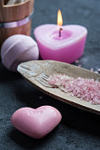 soap closeup with pink lit candle