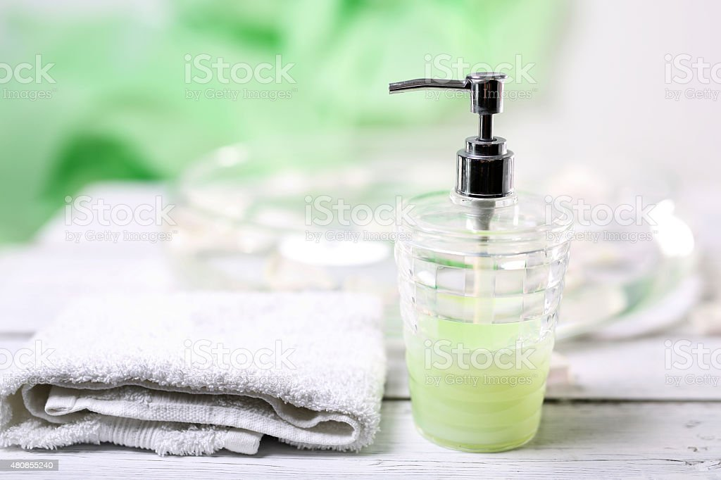 Soap dispenser and towel stock photo