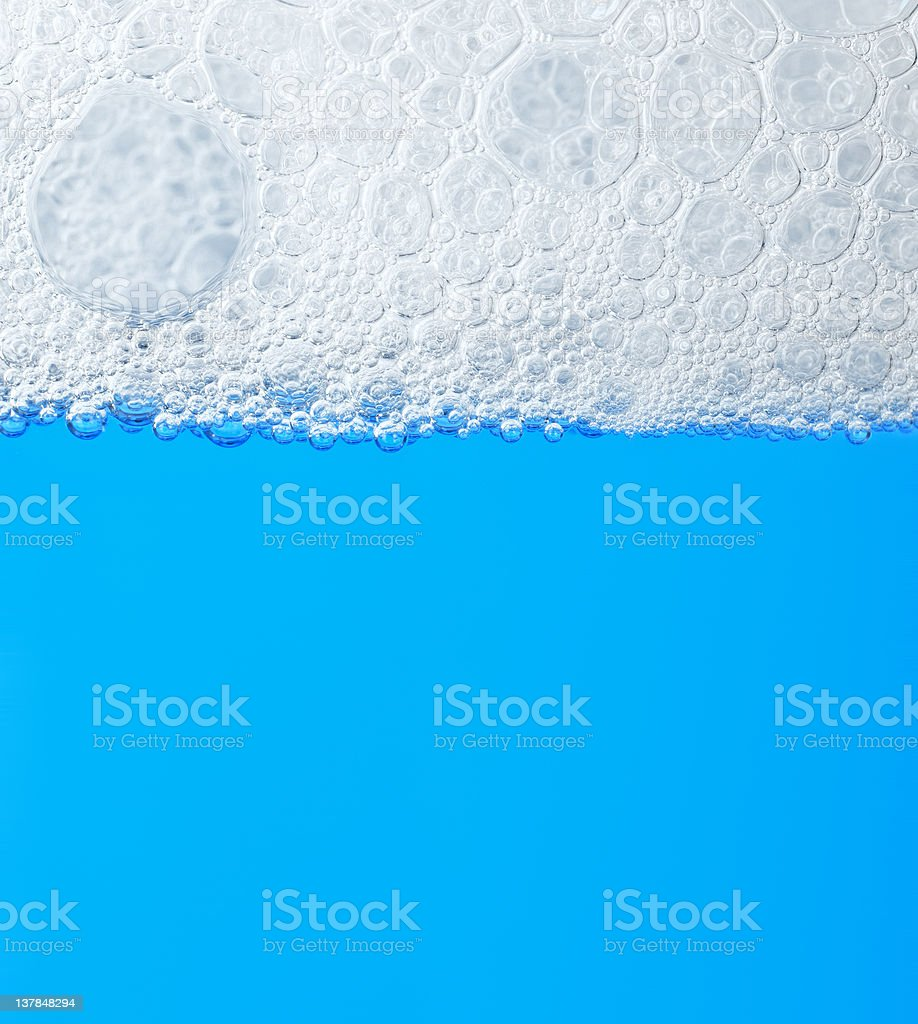 soap froth on the water stock photo