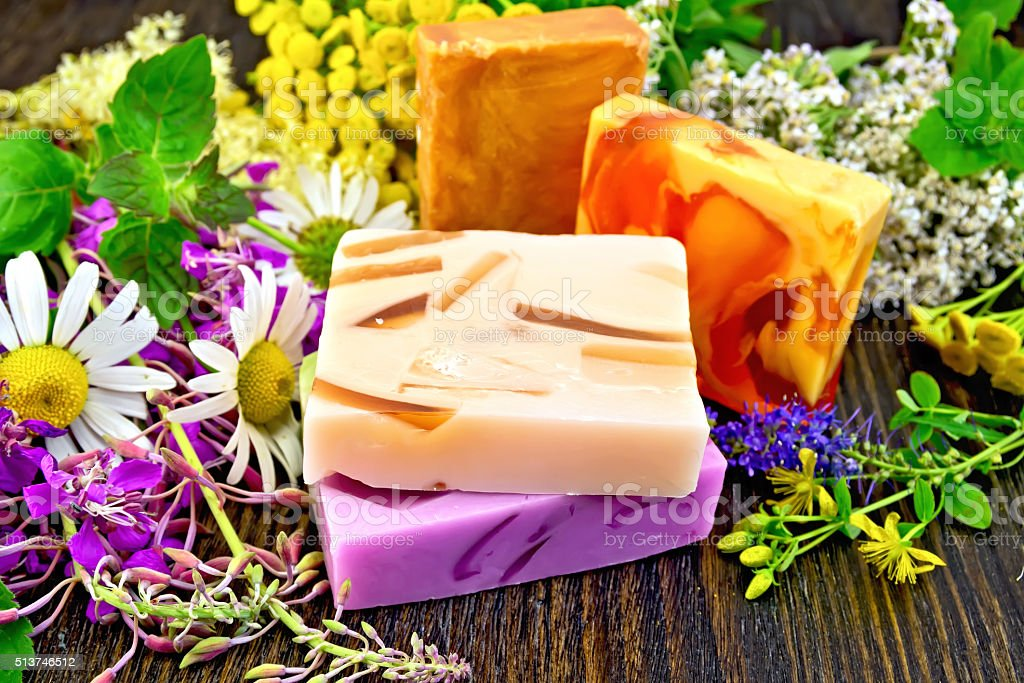 Soap homemade with flowers on board stock photo