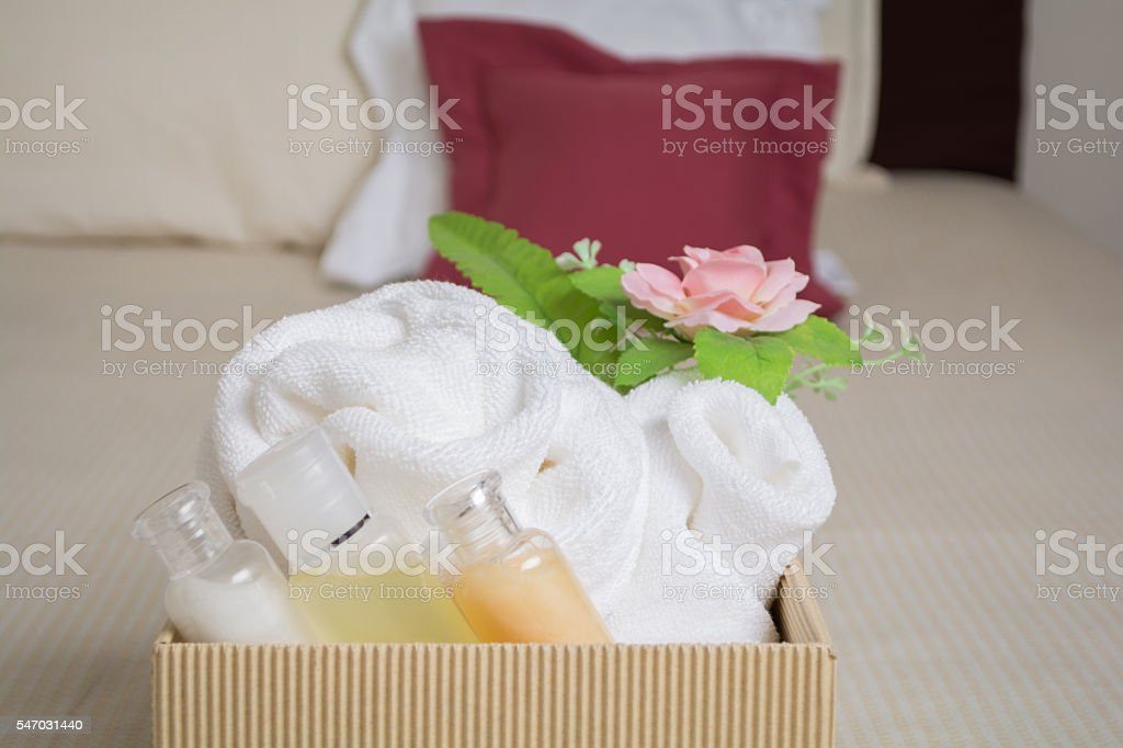 Soap, shampoo, towels in a room hotel stock photo