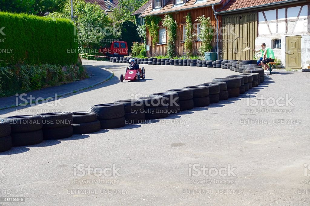 Soapbox racing car driving down the long curve stock photo