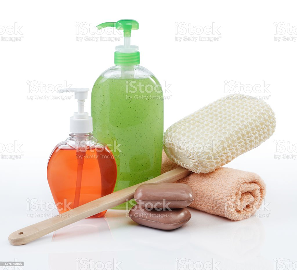 Soaps, body scrub, and a towel royalty-free stock photo