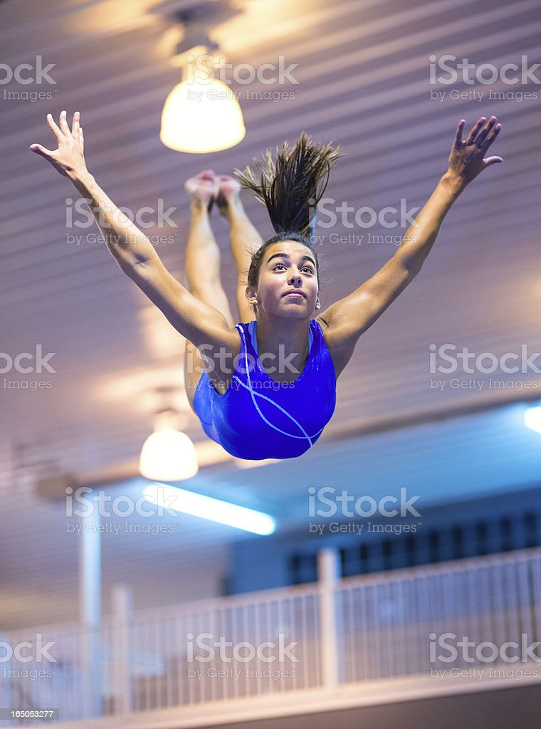 Soaring Female Gymnast's Balance Beam Dismount royalty-free stock photo