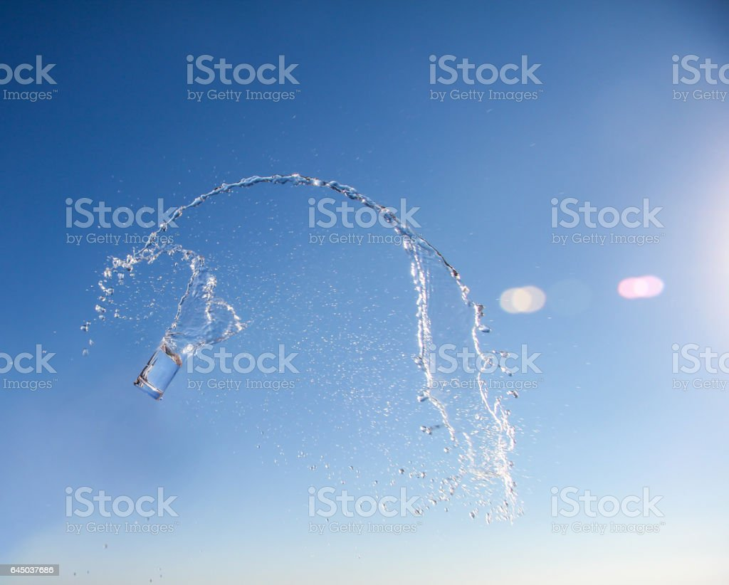 soaring glass with water and splash stock photo