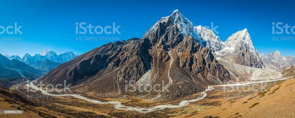 Soaring mountain peaks panorama remote Himalayan valley Khumbu Nepal stock photo