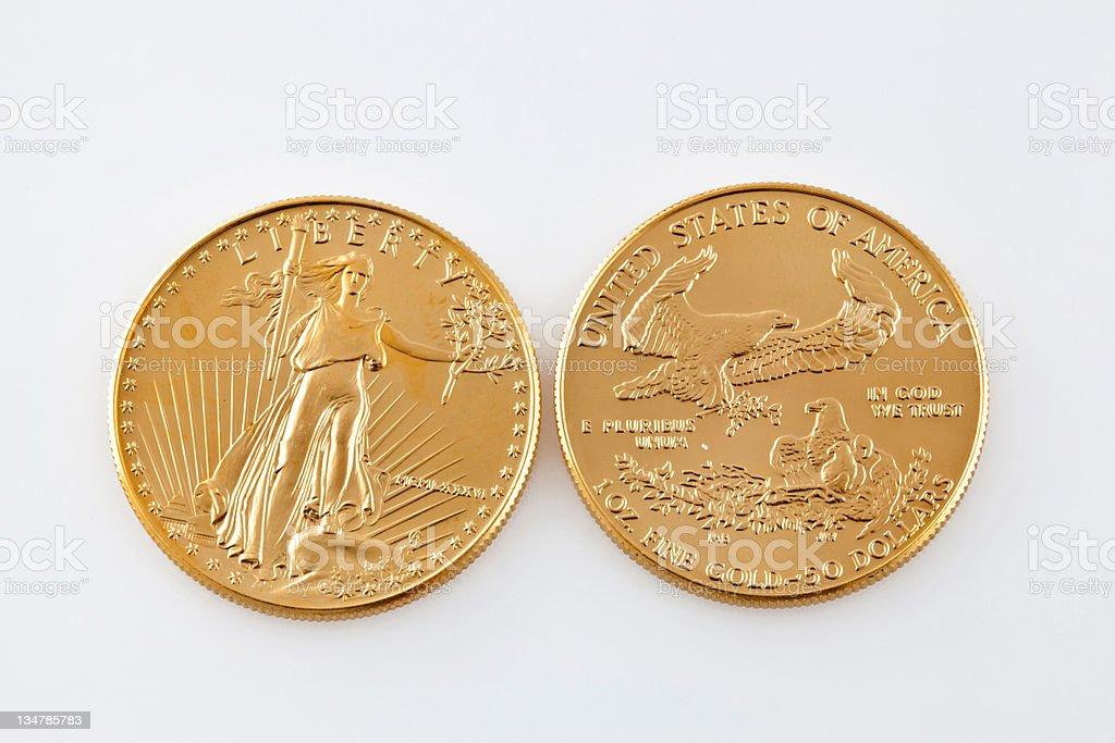 Soaring price of gold coins royalty-free stock photo