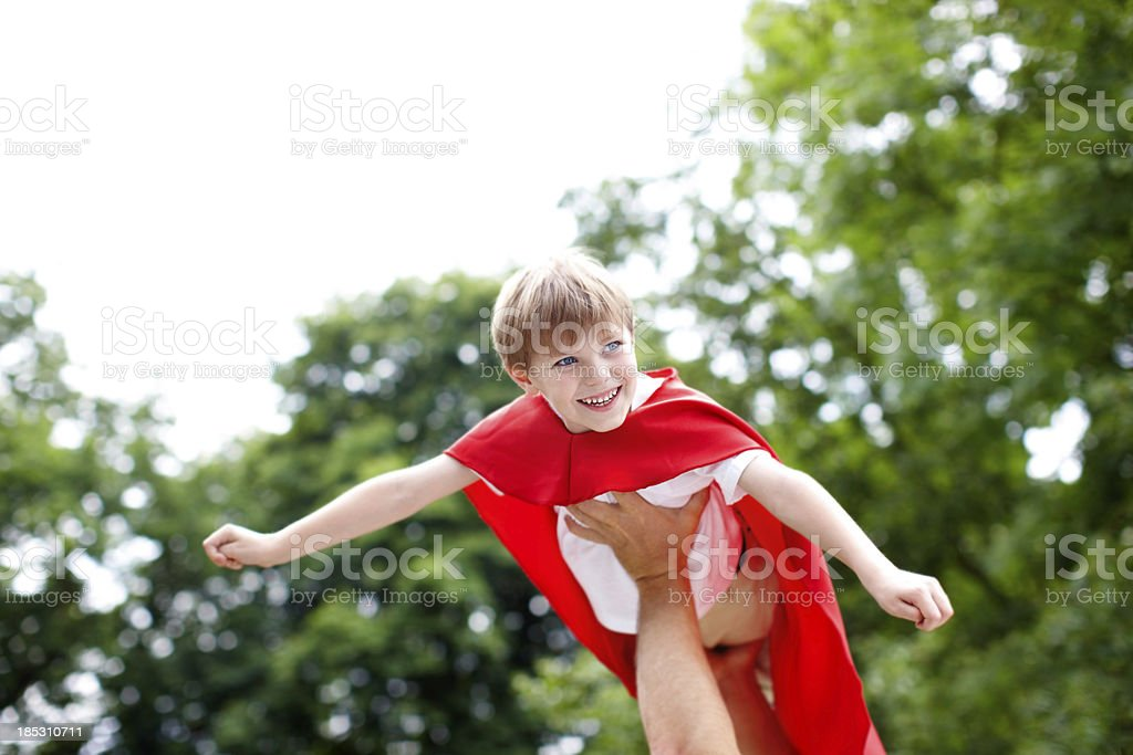 Soaring through the air like a superhero stock photo