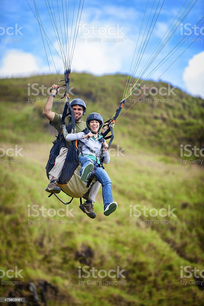 Soaring - Young couple doing tandem paragliding stock photo